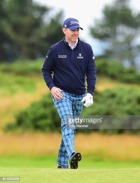 Stephen Gallacher of Scotland wearing Tartan trousers walks down the 9th fairway during Day Two of the AAM Scottish Open at Dundonald Links Golf...