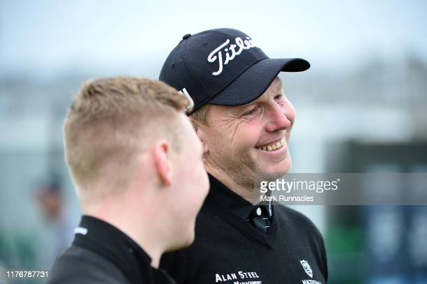 Stephen Gallacher of Scotland with his son and caddie Jack Gallacher during previews for the Alfred Dunhill Links Championship at The Old Course on...
