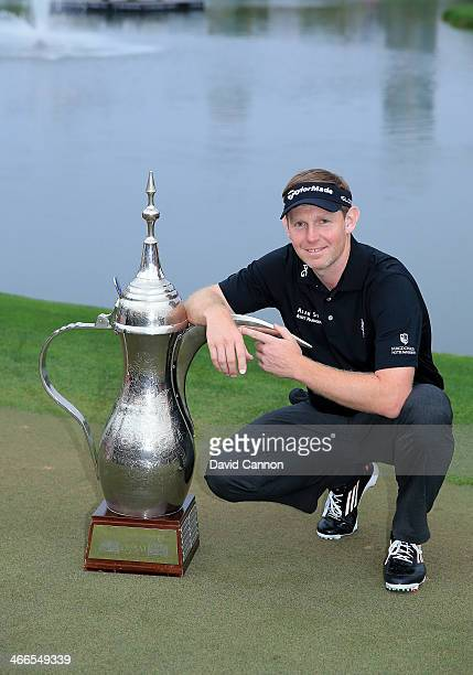 Stephen Gallacher of Scotland with the trophy after the final round where he became the first back to back winner of the Omega Dubai Desert Classic...