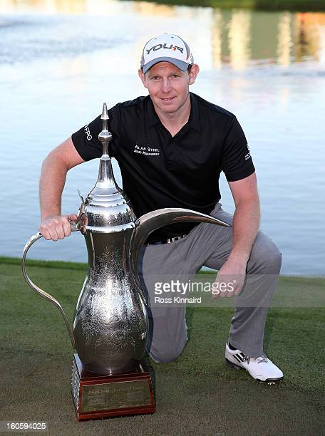 Stephen Gallacher of Scotland with the winners trophy after the final round of the Omega Dubai Desert Classic on February 3, 2013 in Dubai, United...