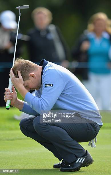 Stephen Gallacher of the Great Britain and Ireland team reacts to a putt during the third day's morning foursomes at the Seve Trophy at Golf de...