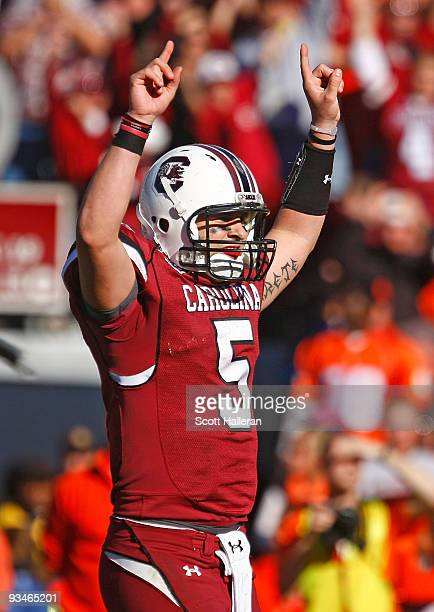 Stephen Garcia of the South Carolina Gamecocks celebrates a second half touchdown against the Clemson Tigers at WilliamsBrice Stadium on November 28...