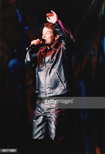 Stephen Gately of Boyzone performs on stage on the 'Smash Hits' tour at the National Exhibition Centre on October 24th 1996 in Birmingham England