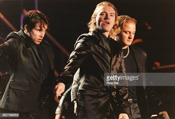 Stephen Gately Ronan Keating and Mikey Graham of Boyzone perform on stage at the National Exhibition Centre on October 6th 1998 in Birmingham England