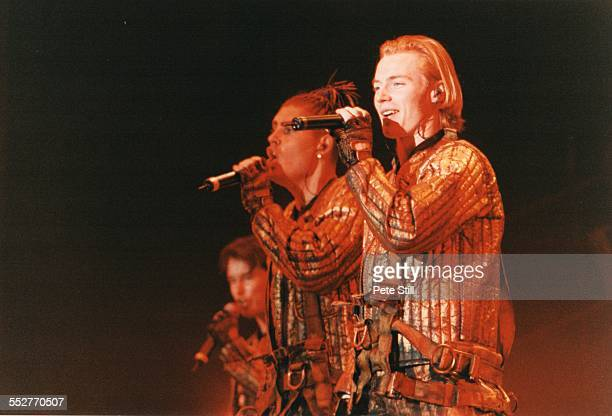 Stephen Gately Shane Lynch and Ronan Keating of Boyzone perform on stage at the National Exhibition Centre on November 11th 1997 in Birmingham England
