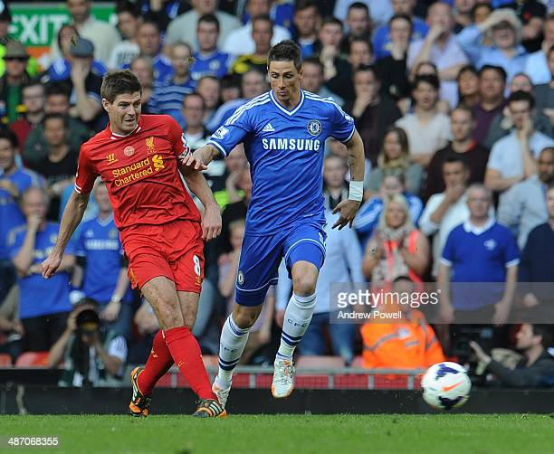 Stephen Gerrard of Liverpool and Fernando Torres of Chelsea compete during the Barclays Premier League match between Liverpool and Chelsea at Anfield...