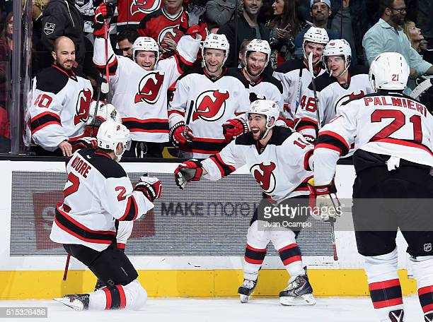 Stephen Gionta and John Moore of the New Jersey Devils celebrate Moore's overtime goal against the Los Angeles Kings on March 12 2016 at Staples...