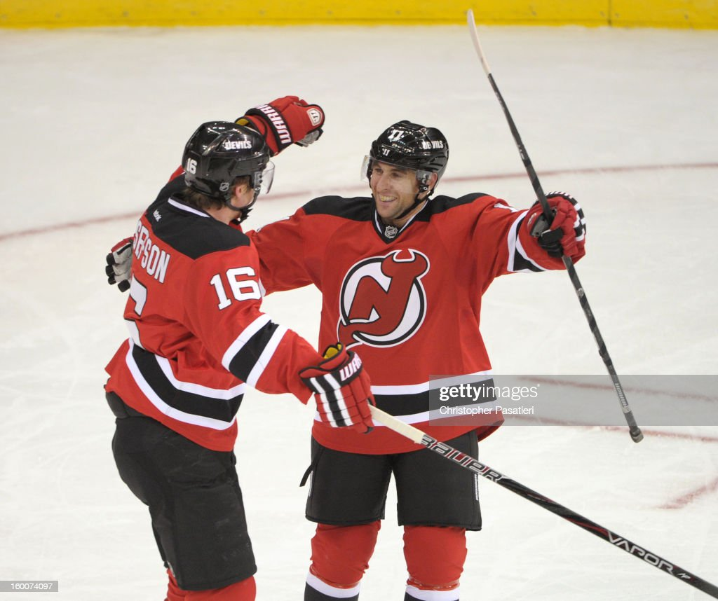 Stephen Gionta #11 of the New Jersey Devils celebrates a first-period goal with Jacob Josefson #16 against the Washington Capitals on January 25, 2013 at the Prudential Center in Newark, New Jersey.