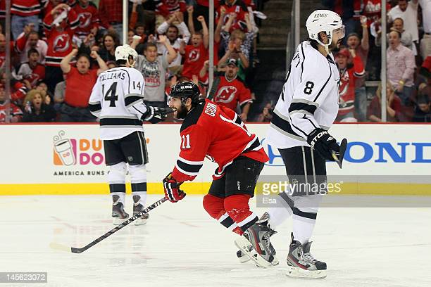 Stephen Gionta of the New Jersey Devils reacts after a goal in the third period as Justin Williams and Drew Doughty of the Los Angeles Kings of the...