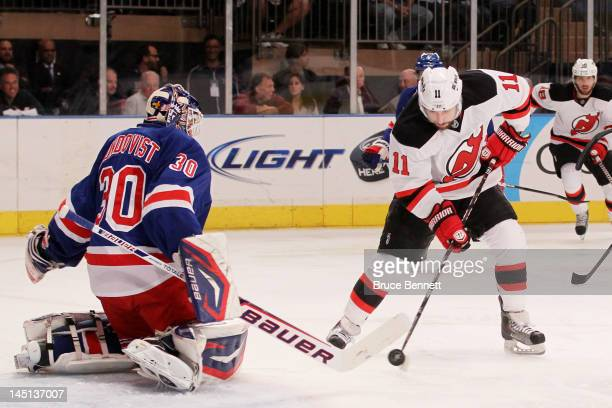 Stephen Gionta of the New Jersey Devils scores a first period goal past Henrik Lundqvist of the New York Rangers in Game Five of the Eastern...