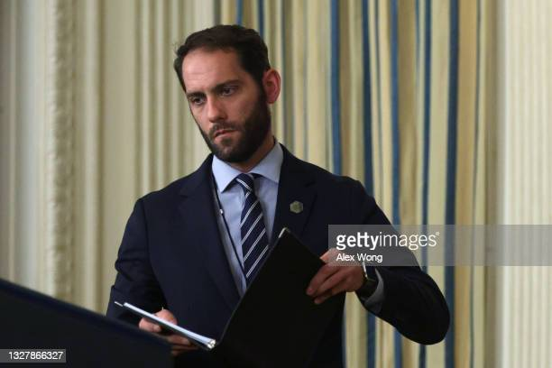 Stephen Goepfert, Personal Aide to U.S. President Joe Biden, put a binder down on the podium prior to an event at the State Dining Room of the White...