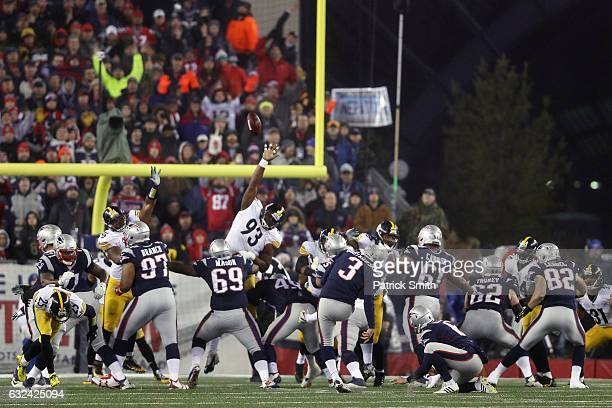 Stephen Gostkowski of the New England Patriots kicks a field goal against the Pittsburgh Steelers during the first quarter in the AFC Championship...
