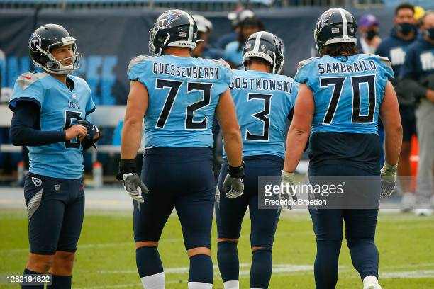 Stephen Gostkowski of the Tennessee Titans is surrounded by teammates David Quessenberry, Ty Sambrailo, and Brett Kern moments after missing a...