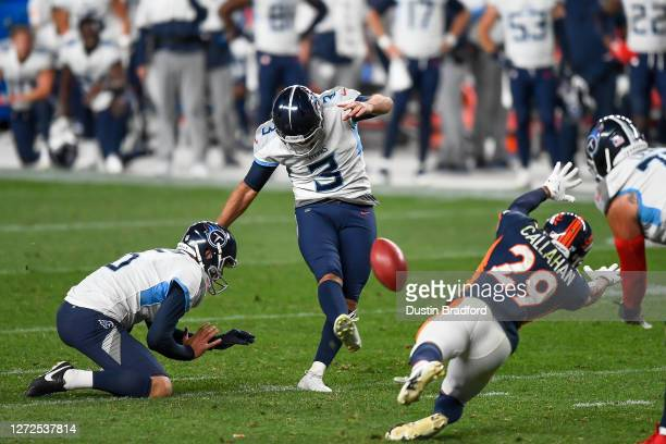 Stephen Gostkowski of the Tennessee Titans kicks a go-ahead fourth quarter field goal as Brett Kern holds and Bryce Callahan of the Denver Broncos...