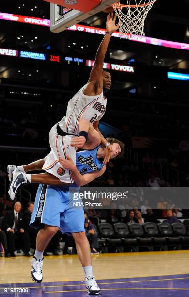 Stephen Graham of the Charlotte Bobcats drives to the basket against Kyrylo Fesenko of the Utah Jazz durng a preseason game at Staples Center on...