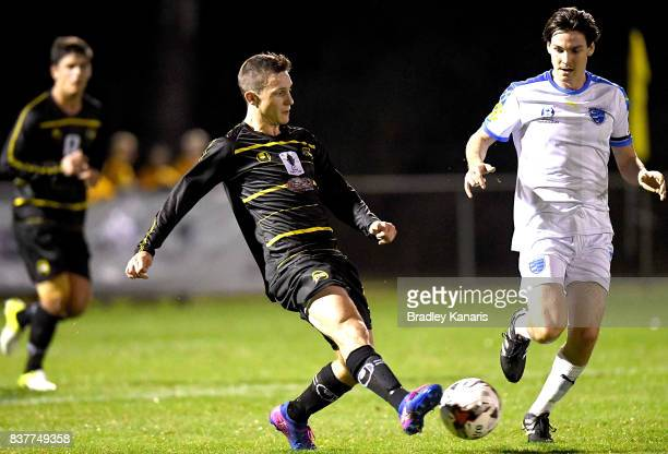 Stephen Green of Moreton Bay gets a kick away during the FFA Cup round of 16 match between Moreton Bay United and Gold Coast City at Wolter Park on...