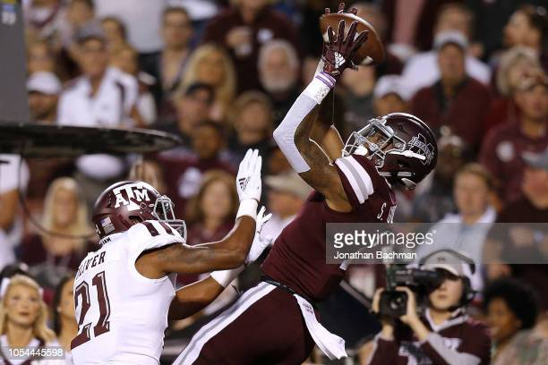 Stephen Guidry of the Mississippi State Bulldogs catches the ball for a touchdown as Charles Oliver of the Texas A&M Aggies defends during the first...