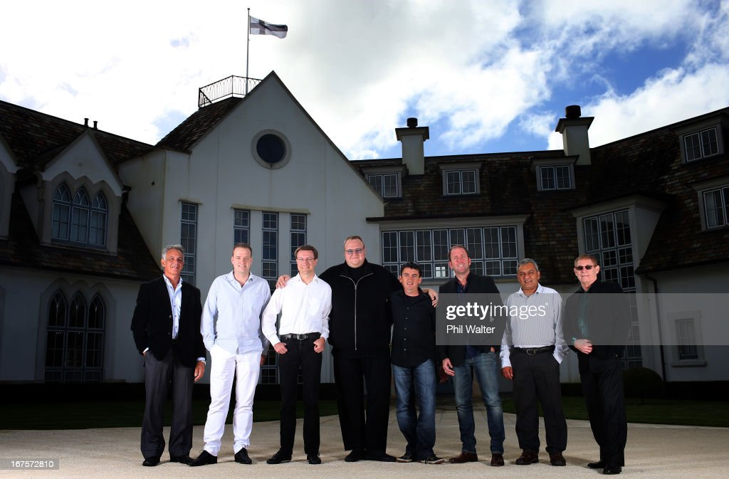 L-R) MEGA CFO Stephen Hall, MEGA Chief programmer Bram van der Kolk, MEGA CTO Mathias Ortmann, MEGA Limited founder, Kim Dotcom, MEGA Chief Angel Tony Lentino, MEGA Limited marketing manager Finn Batato, MEGA CEO, Vikram Kumar and MEGA COO Brian Clarkson pose for a group photo at the Dotcom Mansion on April 26, 2013 in Auckland, New Zealand. MEGA Limited this year launched cloud storage service 'Mega.co.nz', the successor to the controversial file sharing service 'Megaupload.com' shut down by the US Department of Justice in January 2012.