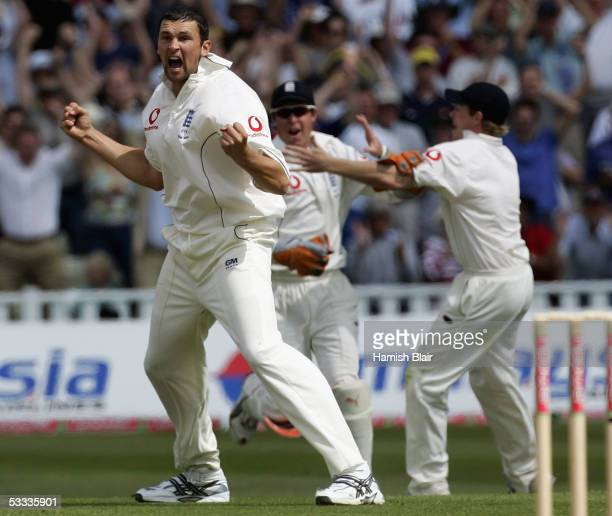 Stephen Harmison of England claims the wicket of Michael Kasprowicz of Australia caught by Geraint Jones of England to give them a two run win during...