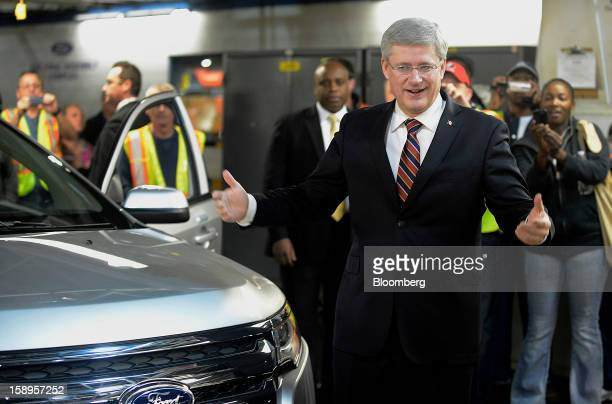 Stephen Harper Canada's prime minister gestures while standing for a photograph at Ford Motor Co of Canada's Oakville Assembly Complex in Oakville...