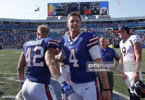 Stephen Hauschka of the Buffalo Bills celebrates their victory with Patrick DiMarco after NFL game action against the Denver Broncos at New Era Field...