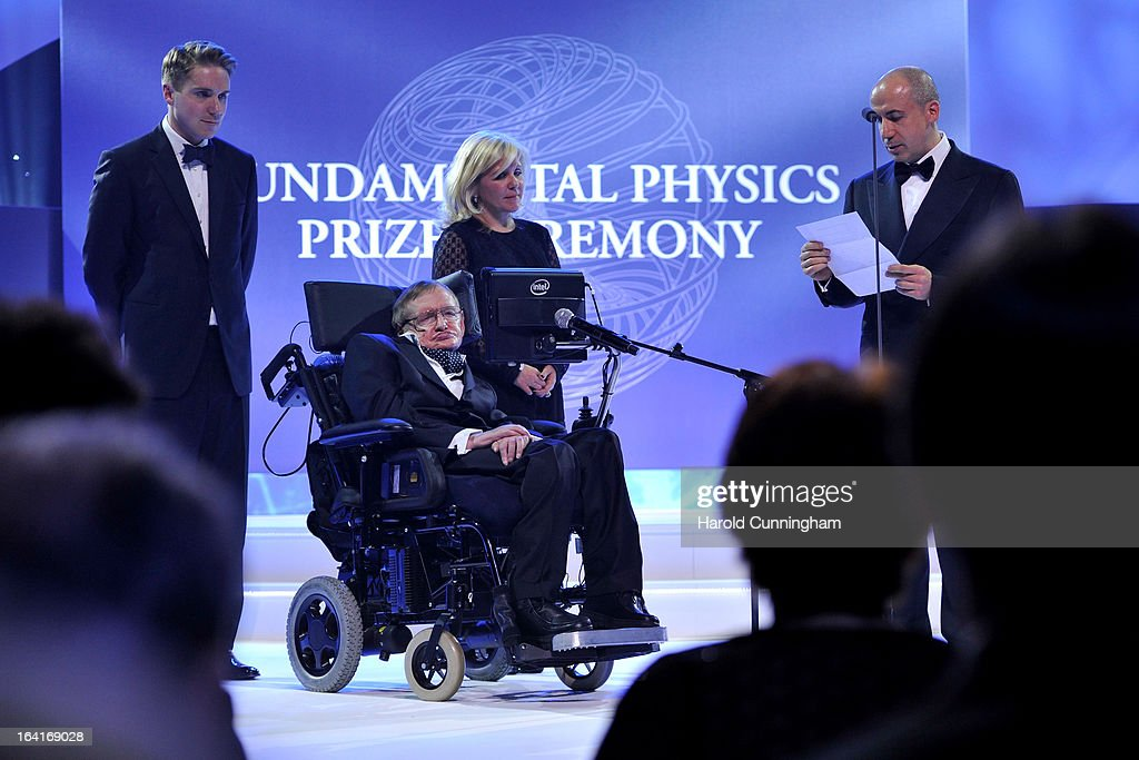 Stephen Hawking (2nd L), laureates of 2013 Physics Frontiers Prize, and his daughter Lucy Hawking (3rd L) look on as Yuri Milner (R), Fundamental Physics Prize founder, delivers a speech during the Fundamental Physics Prize Foundation Inaugural Prize Ceremony at the CICG on March 20, 2013 in Geneva, Switzerland. The prize is today the most financially lucrative scientific prize in the world, with its nine Inaugural recipients to receive 27 million USD collectively, providing them more freedom and opportunity to pursue future accomplishment. Led by a not-for-profit corporation, the Fundamental Physics Prize Foundation dedicates itself to advance the knowledge of the Universe at the deepest level.