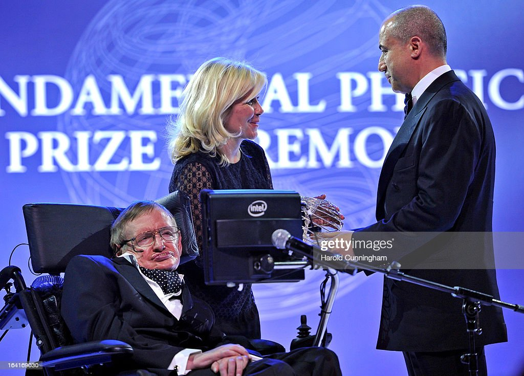Stephen Hawking (L), laureates of 2013 Physics Frontiers Prize, and his daughter Lucy Hawking (C) look on as Yuri Milner (R), Fundamental Physics Prize founder, delivers his award during the Fundamental Physics Prize Foundation Inaugural Prize Ceremony at the CICG on March 20, 2013 in Geneva, Switzerland. The prize is today the most financially lucrative scientific prize in the world, with its nine Inaugural recipients to receive 27 million USD collectively, providing them more freedom and opportunity to pursue future accomplishment. Led by a not-for-profit corporation, the Fundamental Physics Prize Foundation dedicates itself to advance the knowledge of the Universe at the deepest level.