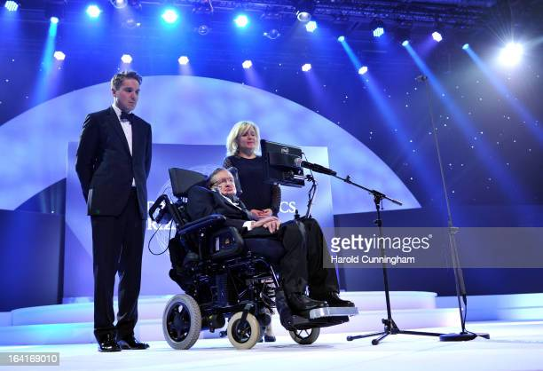 Stephen Hawking laureates of 2013 Physics Frontiers Prize delivers a speech as his daughter Lucy Hawking looks on during the Fundamental Physics...