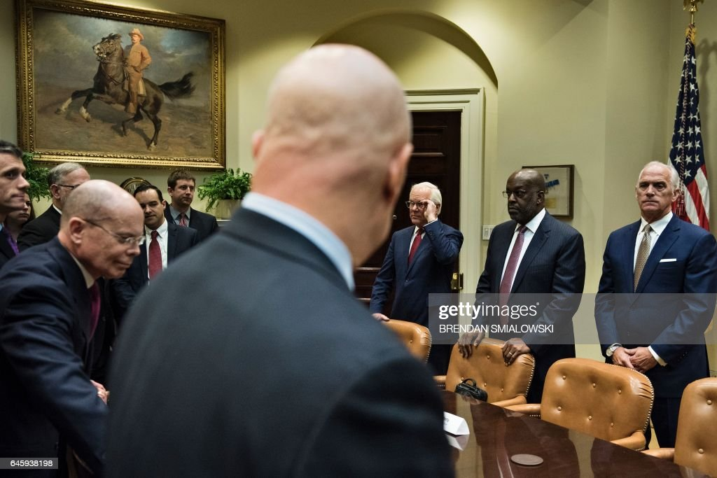 Stephen Hemsley, CEO of UnitedHealth Group, Patrick Geraghty, CEO of Florida Blue, Joseph R. Swedish, CEO of Anthem, Bernard Tyson, CEO of Kaiser Permanente, Daniel J. Hilferty, President and CEO of of Independence Blue Cross, and others wait for US President Donald Trump before a meeting with health insurance executives in the Roosevelt Room of the White House February 27, 2017 in Washington, DC. / AFP / Brendan Smialowski