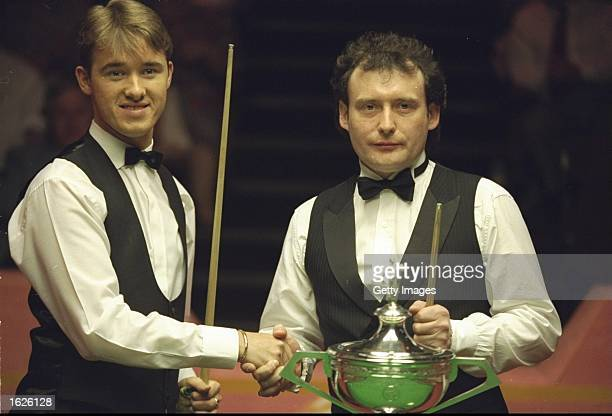 Stephen Hendry of Scotland and Jimmy White of England shake hands before the Embassy World Snooker Championship Final at the Crucible Theatre in...