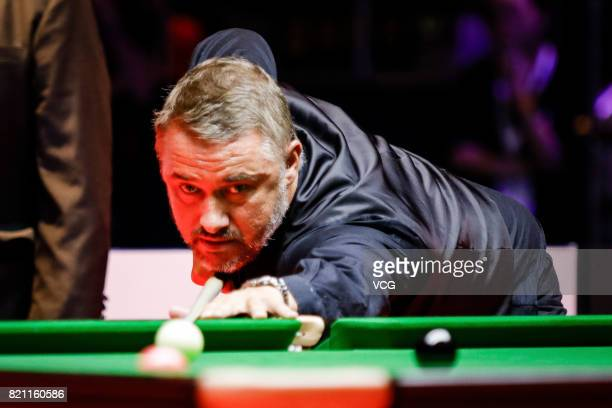 Stephen Hendry of Scotland plays a shot during the third exhibition game against Jimmy White of England on day four of 2017 Hong Kong Masters at...