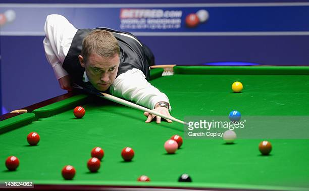 Stephen Hendry of Scotland plays a shot in his quarter final match against Stephen Maguire of Scotland during the Betfred.com World Snooker...