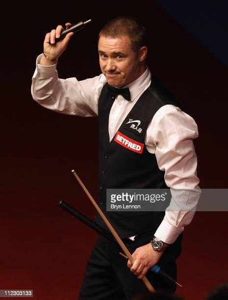 Stephen Hendry of Scotland waves after beating Joe Perry of England in his round one game on day three of the Betfred.com World Snooker Championship...