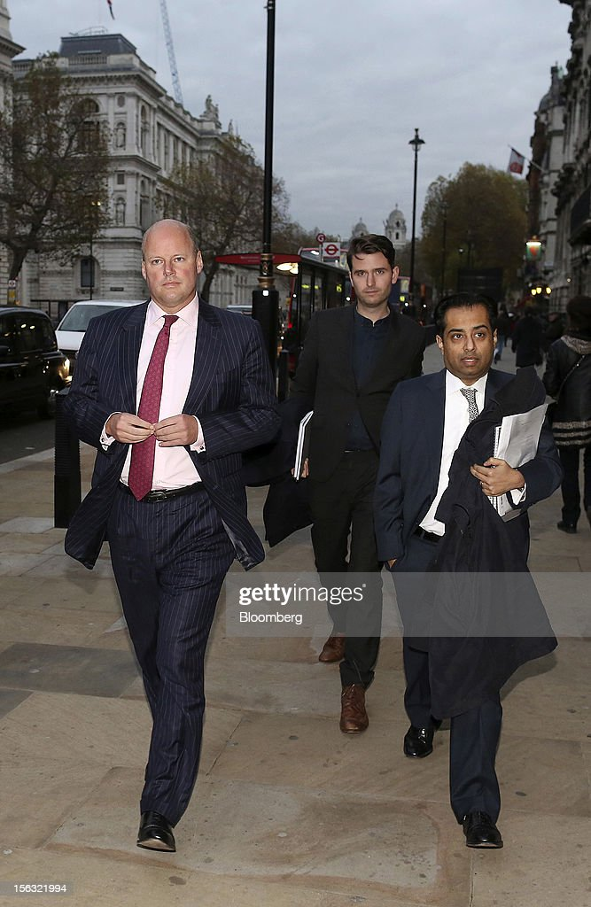 Stephen Hester, chief executive officer of the Royal Bank of Scotland Group Plc (RBS), left, arrives to give evidence to a Parliamentary Select Committee on Banking Standards in London, U.K., on Tuesday, Nov. 13, 2012. Royal Bank of Scotland Group Plc said it was concerned that the Independent Commission on Banking's proposed firewalls around consumer banking units could mean they are wrongly percieved as safer than the non-ringfenced parts of the business. Photographer: Simon Dawson/Bloomberg via Getty Images