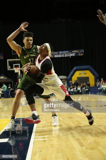 Stephen Hicks of the Fort Wayne Mad Ants battles Craig Sword of the Erie Bayhawks on March 17 2018 at Memorial Coliseum in Fort Wayne Indiana NOTE TO...