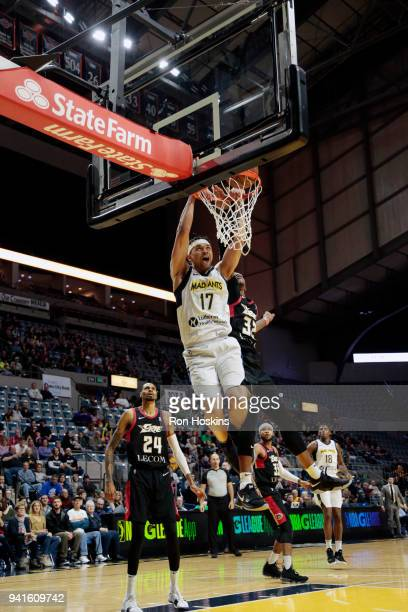 Stephen Hicks of the Fort Wayne Mad Ants battles Craig Sword of the Erie Bayhawks in the 2018 Eastern Conference semifinals of the NBA G League on...