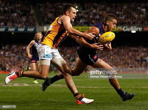 Stephen Hill of the Dockers is tackled by Luke Hodge of the Hawks during the 2015 AFL First Preliminary Final match between the Fremantle Dockers and...