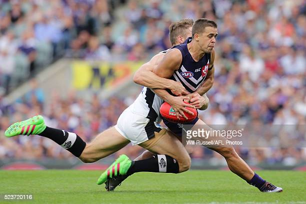 Stephen Hill of the Dockers is tackled by Zach Tuohy of the Blues during the round five AFL match between the Fremantle Dockers and the Carlton Blues...