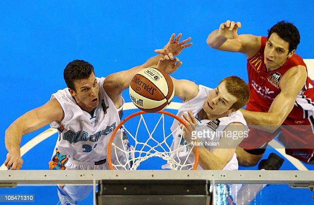 Stephen Hoare and Tom Garlepp of the Blaze and Oscar Forman of the Hawks contest possession during the round one NBL match between the Wollongong...