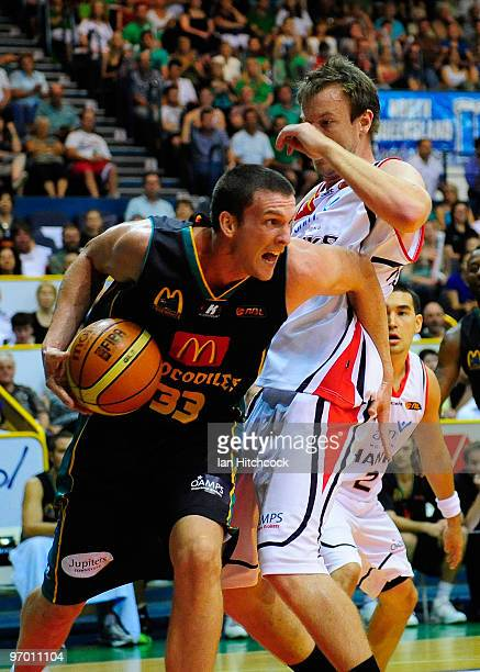 Stephen Hoare of the Crocodiles drives past Cameron Tragardh of the Hawks during game two of the NBL semi final series between the Townsville...