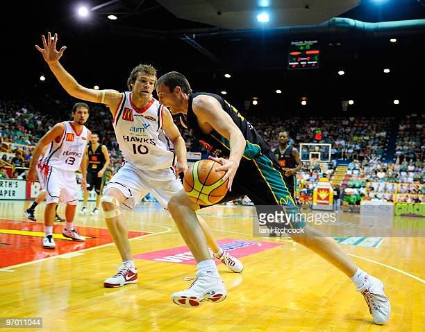 Stephen Hoare of the Crocodiles drives past Larry Davidson of the Hawks during game two of the NBL semi final series between the Townsville...