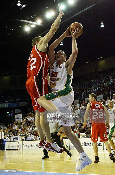 Stephen Hoare of Townsville is blocked by David Gruber of the Hawks during the round 17 NBL match between the Wollongong Hawks and the Townsville...