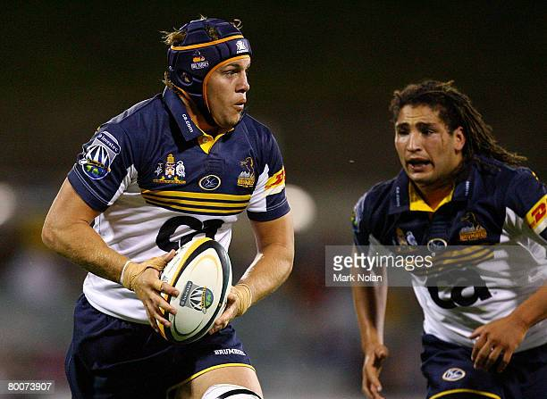Stephen Hoiles of the Brumbies looks for support during the round three Super 14 match between the ACT Brumbies and the Queensland Reds at Canberra...