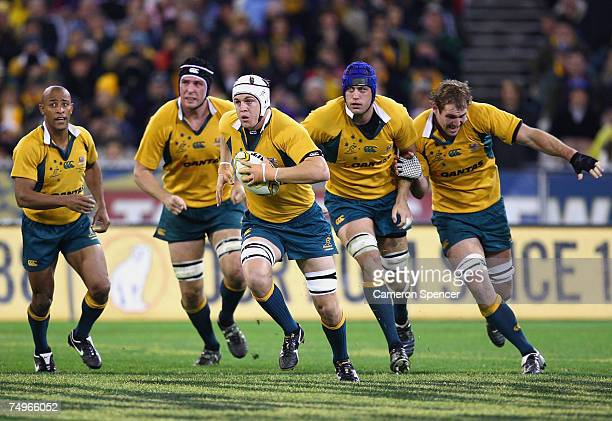 Stephen Hoiles of the Wallabies runs the ball with team mates in support during the 2007 Tri Nations match between Australia and New Zealand at the...