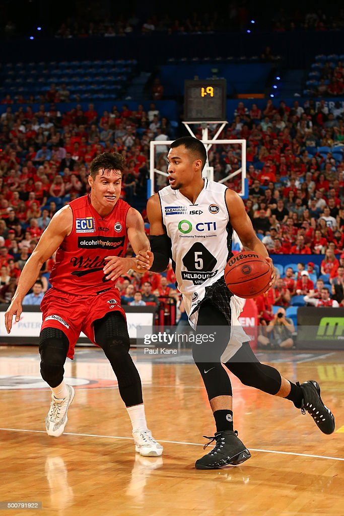 Stephen Holt of United drives into the key against Jarrod Kenny of the Wildcats during the round 10 NBL match between the Perth Wildcats and Melbourne United at Perth Arena on December 10, 2015 in Perth, Australia.