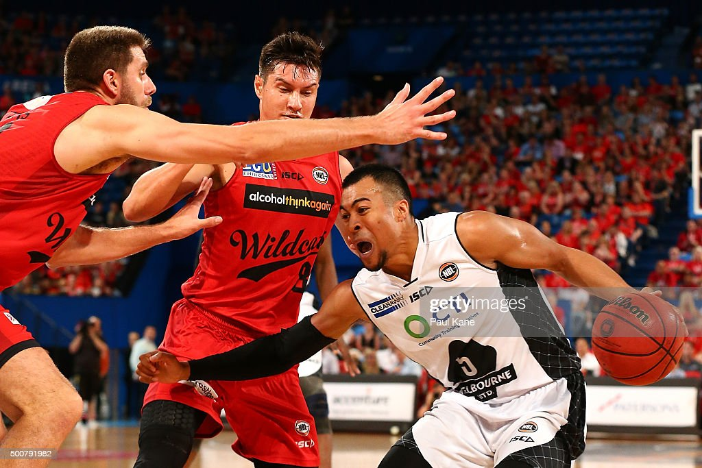 Stephen Holt of United gets blocked by Tom Jervis and Jarrod Kenny of the Wildcats during the round 10 NBL match between the Perth Wildcats and Melbourne United at Perth Arena on December 10, 2015 in Perth, Australia.