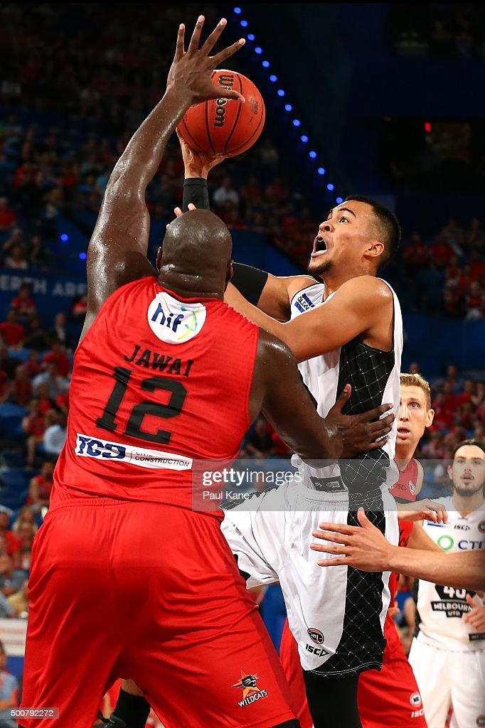 Stephen Holt of United lays up against Nate Jawai of the Wildcats during the round 10 NBL match between the Perth Wildcats and Melbourne United at Perth Arena on December 10, 2015 in Perth, Australia.