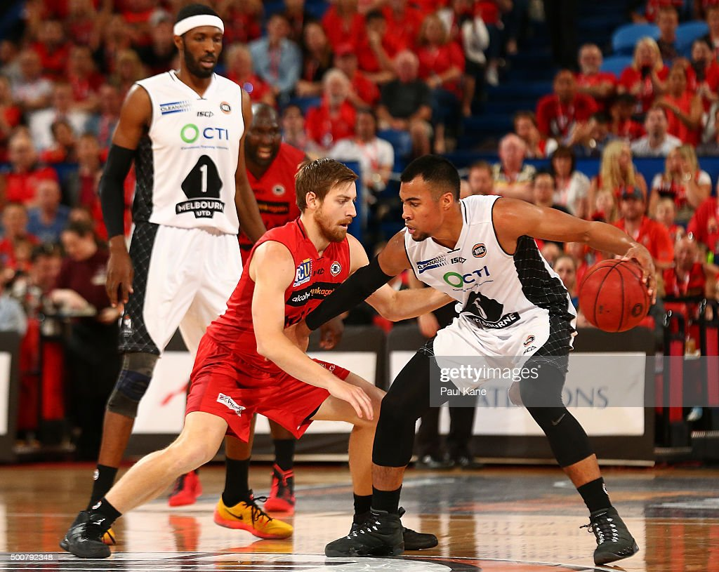 Stephen Holt of United looks to work the ball against Corban Wroe of the Wildcats during the round 10 NBL match between the Perth Wildcats and Melbourne United at Perth Arena on December 10, 2015 in Perth, Australia.