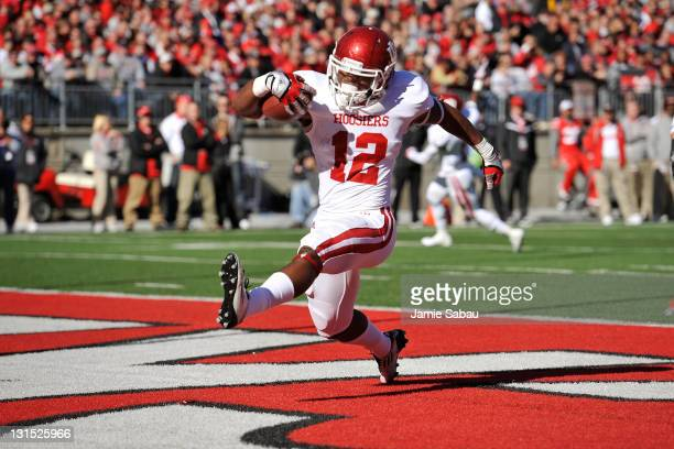 Stephen Houston of the Indiana Hoosiers celebrates his five-yard touchdown run in the first half against the Ohio State Buckeyes at Ohio Stadium on...