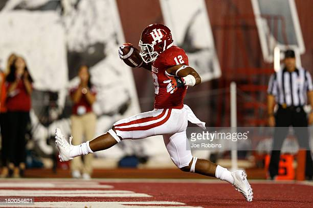 Stephen Houston of the Indiana Hoosiers runs into the end zone for a 13yard touchdown in the first half of the game against the Ball State Cardinals...